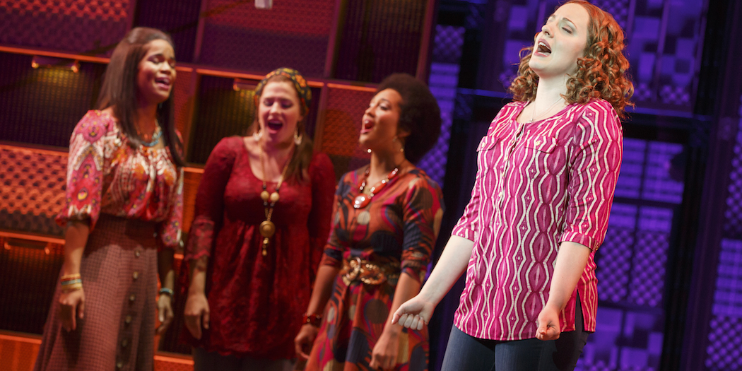 (L-R) Britney Coleman, Sarah Bockel, Ashley Blanchet and, in the foreground, Abby Mueller as Carole King. (Courtesy of Joan Marcus/Broadway in Boston)