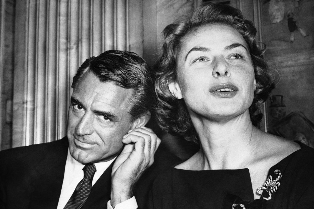 In this file photo, actress Ingrid Berman tells newsmen in London on Nov. 13, 1957 about her new picture in which she will co-star with Cary Grant, who listens to her comments. (AP)