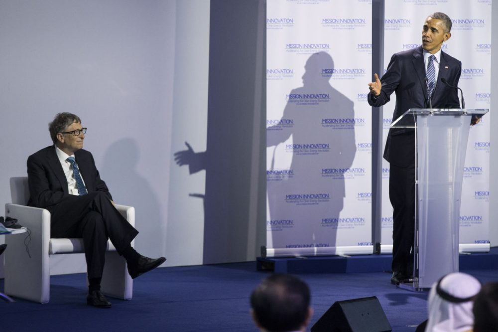 Bill Gates looks on as President Obama delivers remarks during an event at COP21 outside Paris, on Monday. (AP Photo/Evan Vucci)