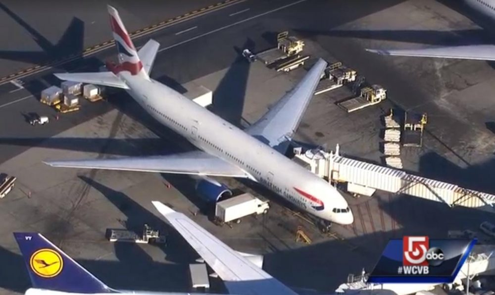 Kamila Dolniak, 32, of Poland, was intoxicated and had to be restrained after trying to open an exit door while the plane was in flight, according to Massachusetts State Police. Now she's facing charges. The plane Dolniak was on is pictured here arriving at Logan Tuesday afternoon. (WCVB screenshot)