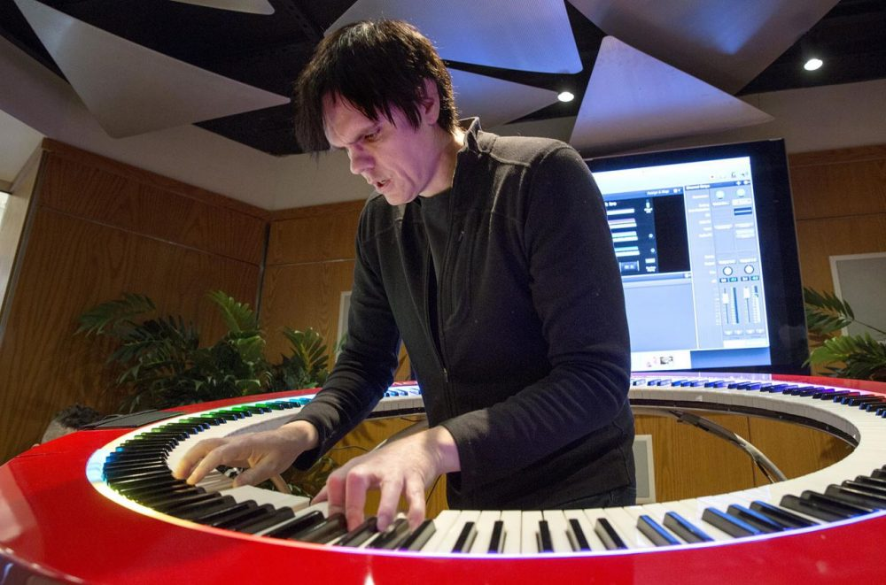 Keyboard player Brockett Parsons plays a 360-degree keyboard at the Berklee College of Music. Parsons is part of Boston startup PianoArc, which produced the circular keyboard and hopes it will make a mark in the music industry. (Robin Lubbock/WBUR)