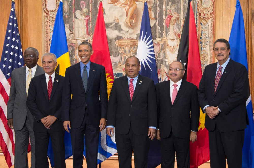 US President Barack Obama (3rd L) poses with Barbados Prime Minister Freundel Stuart (L), Kiribati President Anote Tong (2nd L), Mashall Islands President Christopher Loeak (3rd R), Papua New Guinea Prime Minister Peter O'Neil (2nd R) and St. Lucia Prime Minister Kenny Anthony (R) during a photo for the small island nations multilateral meeting at the Organization for Economic Co-Operation and Development Centre in Paris, on December 1, 2015.  (Jim Watson/AFP/Getty Images)
