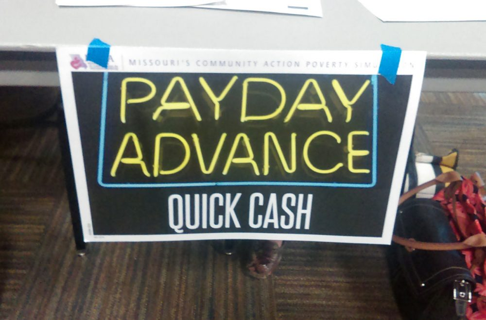"The poverty simulation included this ""payday advance"" table. (Gabrielle Ware/Georgia Public Broadcasting)"