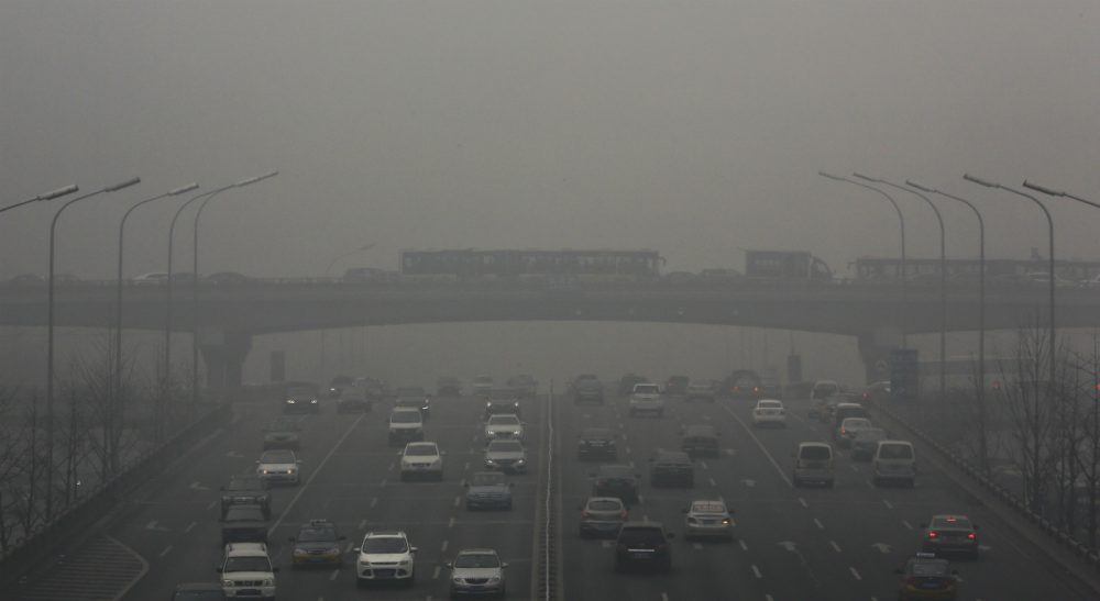 Buses and cars are clogged with heavy traffic on the roads on a heavily polluted day in Beijing, Monday, Nov. 30, 2015. Beijing on Sunday, Nov. 29 issued its highest smog alert of the year following air pollution in capital city reached hazardous levels as smog engulfed large parts of the country despite efforts to clean up the foul air. (Andy Wong/ AP)