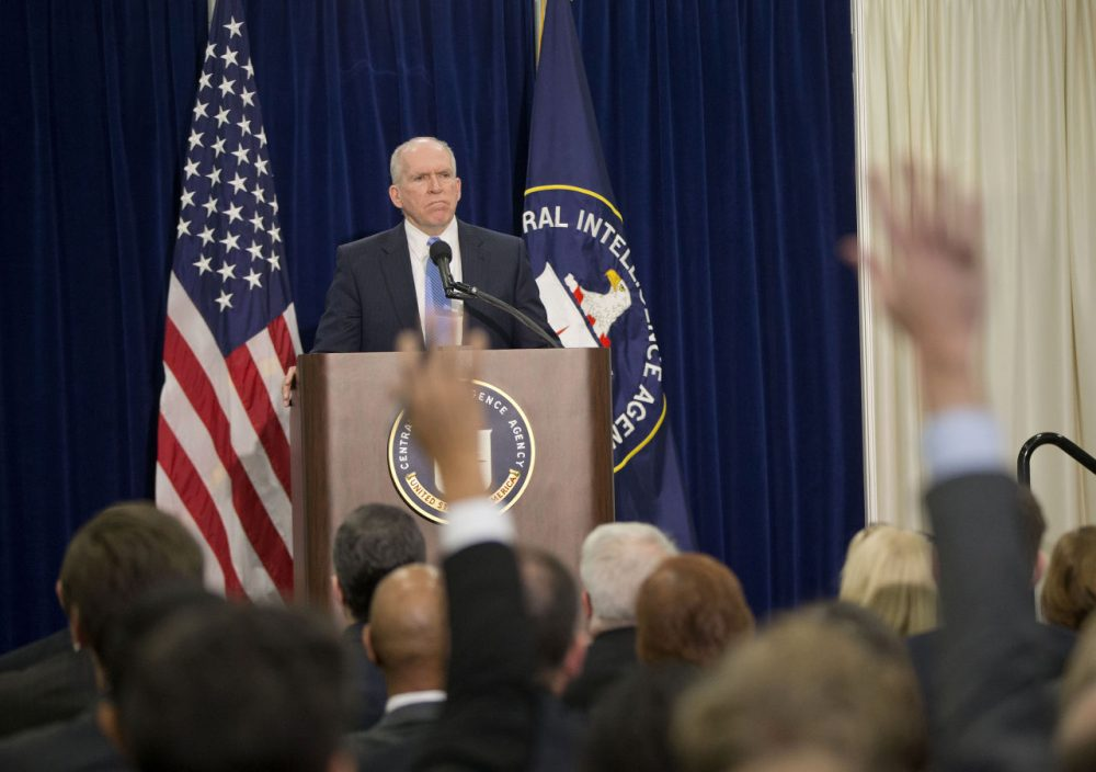Members of the media raise their hands during CIA Director John Brennan's news conference at CIA headquarters in Langley, Va., Thursday, Dec. 11, 2014. Brennan was defending his agency from accusations in a Senate report that it used inhumane interrogation techniques against terrorist suspect with no security benefits to the nation. (Pablo Martinez Monsivais/AP Photo)
