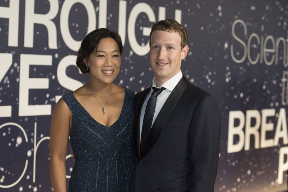 In this Nov. 9, 2014 file photo, Priscilla Chan and Mark Zuckerberg arrive at the 2nd Annual Breakthrough Prize Award Ceremony at the NASA Ames Research Center in Mountain View, Calif. Zuckerberg and Chan have announced they will be donating 99 percent of their Facebook shares - currently valued at more than $45 billion - to charitable purposes. (Peter Barreras/Invision/AP)