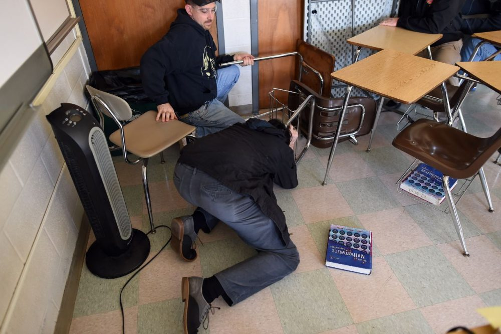 "Participants barricade a door of a classroom to block an ""active shooter"" during ALICE training at the Harry S Truman High School in Levittown, Pennsylvania, on November 3, 2015. (Jewel Samad/AFP/Getty Images)"