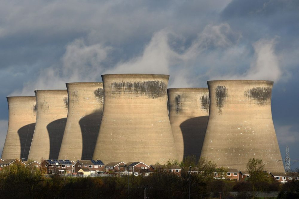 A general view shows a residential estate in front of the Ferrybridge C power station, near Knottingley in northern England, on November 10, 2015. The coal fired power station is owned by energy company SSE, and is expected to close by the end of March 2016. (Oli Scarff/AFP/Getty Images)