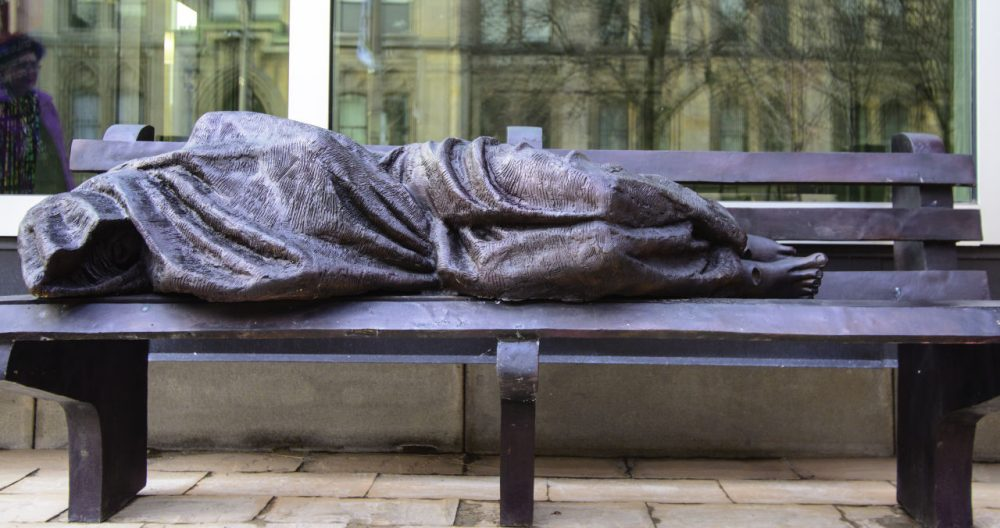 A homeless Jesus statue outside Regis College, a theological college at the University of Toronto, Canada. (Michael_Swan/Flickr)