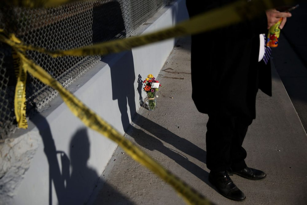 Flowers sit on the sidewalk on Waterman Avenue near the Inland Regional Center on December 3, 2015 in San Bernardino, California. Police continue to investigate a mass shooting at the Inland Regional Center in San Bernardino that left 14 people dead. (Justin Sullivan/Getty Images)