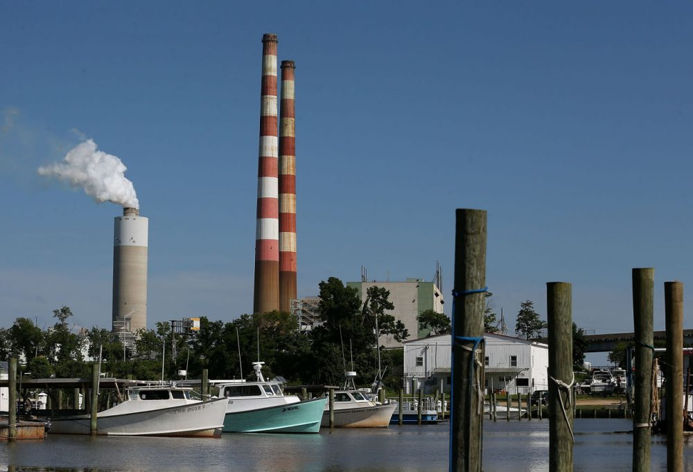 Boats are docked at the Aqualand Marina as emissions spew out of a large stack nearby at the coal-fired Morgantown Generating Station June 29, 2015 in Newburg, Maryland. (Mark Wilson/Getty Images)