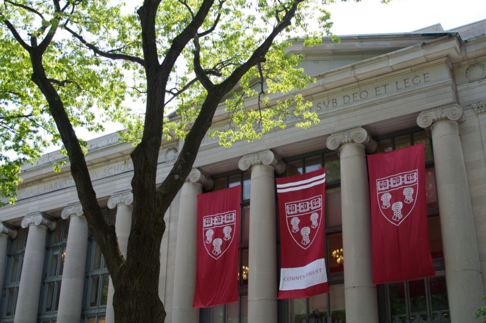 The Harvard Law School seal can be seen on banners decorating the library for commencement in May 2011. (nkcphoto/Flickr)