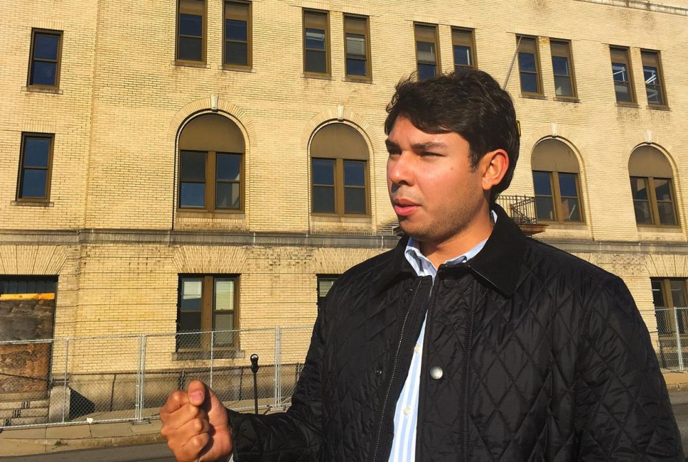 Fall River Mayor-elect Jasiel Correia stands in front of the city's former police station, which he hopes will be developed into market-rate apartments. Correia says that will help attract a middle class workforce, and it's just one of the goals he has for when he becomes mayor next month. (Simon Rios/WBUR)