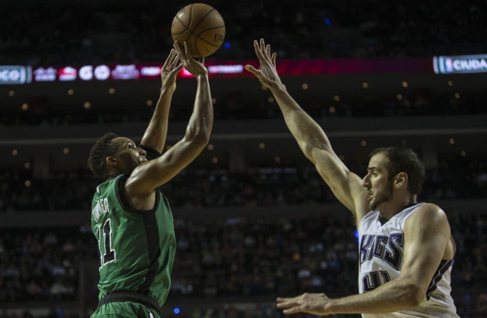 Boston Celtics' Evan Turner, left, gets to ready to try a shot under pressure of Sacramento Kings' Kosta Koufos during a game Thursday night. (Christian Palma/AP)