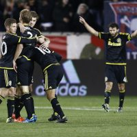 HARRISON, NJ - NOVEMBER 29:  Members of the Columbus Crew celebrate their Eastern Conference win over the New York Red Bulls  after their match at Red Bull Arena on November 29, 2015 in Harrison, New Jersey.  (Photo by Jeff Zelevansky/Getty Images)
