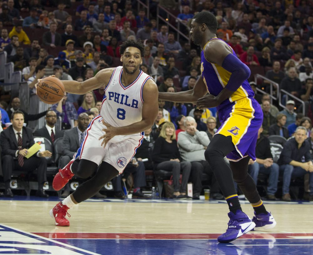 PHILADELPHIA, PA - DECEMBER 1: Jahlil Okafor #8 of the Philadelphia 76ers dribbles the ball with Roy Hibbert #17 of the Los Angeles Lakers defending on December 1, 2015 at the Wells Fargo Center in Philadelphia, Pennsylvania. NOTE TO USER: User expressly acknowledges and agrees that, by downloading and or using this photograph, User is consenting to the terms and conditions of the Getty Images License Agreement. The 76ers defeated the Lakers 103-91. (Photo by Mitchell Leff/Getty Images)
