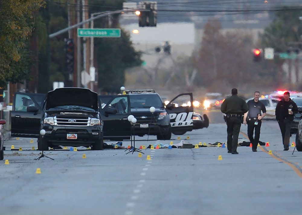 Law enforcement officials continue their investigation around the Ford SUV vehicle that was the scene where suspects of the shooting at the Inland Regional Center were killed on December 4, 2015 in San Bernardino, California. Police continue to investigate a mass shooting at the Inland Regional Center in San Bernardino that left at least 14 people dead and another 17 injured on December 2nd.  (Joe Raedle/Getty Images)