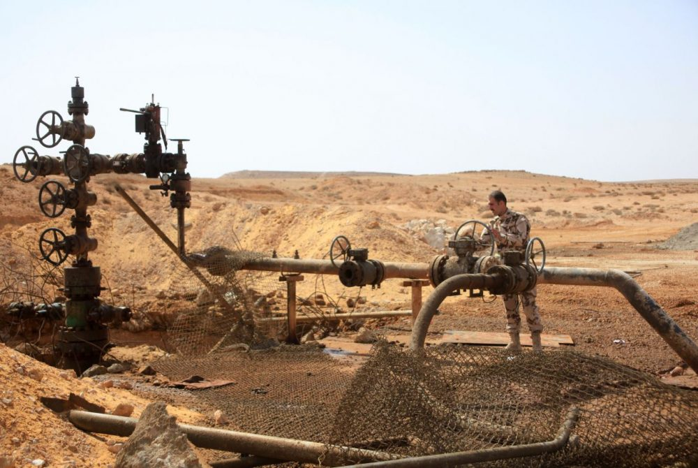 A member of the Syrian government forces stands next to a well at Jazel oil field, near the ancient city of Palmyra in the east of Homs province after they retook the area from Islamic State group fighters on March 9, 2015. Recent U.S.-led coalition airstrikes have frequently targeted oil facilities run by ISIS jihadists, who according to some estimates earn more than $1 million per day from oil sales. (STR/AFP/Getty Images)