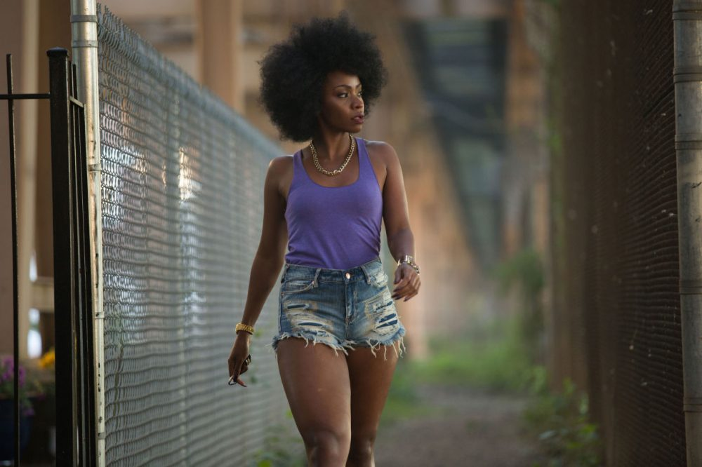 "This photo provided by Roadside Attractions and Amazon Studios shows Teyonah Parris as Lysistrata in Spike Lee's film, ""Chi-Raq."" The movie opens in U.S. theaters on Dec. 4, 2015.  (Parrish Lewis/Roadside Attractions/Amazon Studios via AP)"