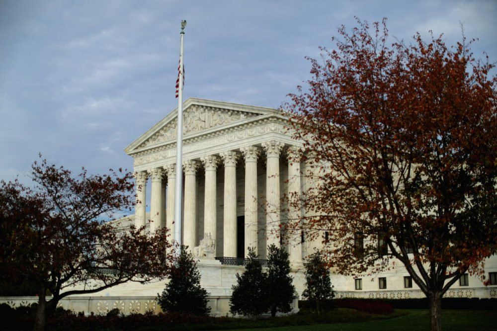 The United States Supreme Court building is framed by fall foliage November 6, 2015 in Washington, D.C. (Chip Somodevilla/Getty Images)