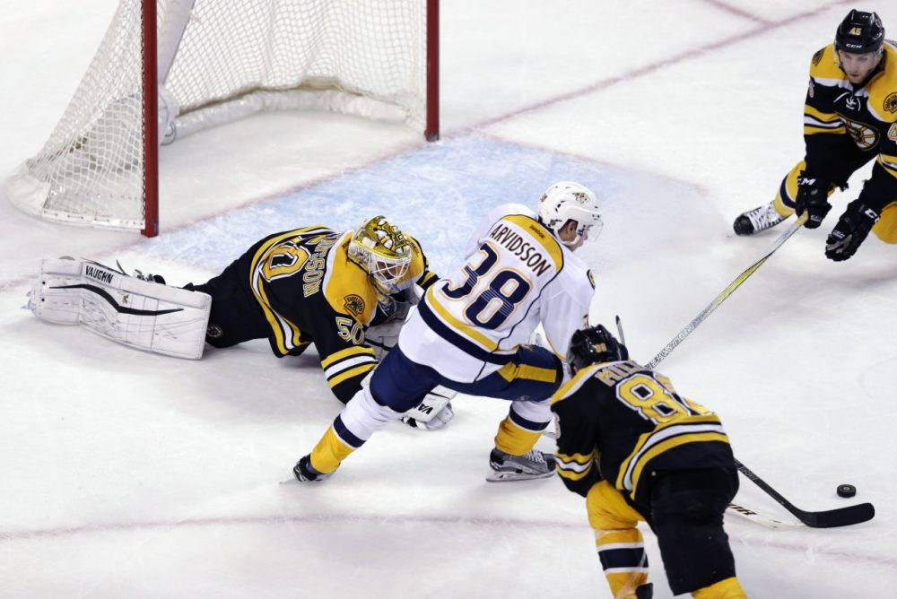 Nashville Predators right wing Viktor Arvidsson (38) eludes Boston Bruins goalie Jonas Gustavsson (50) as he sets up the game winning goal during last night's game. (Charles Krupa/AP)