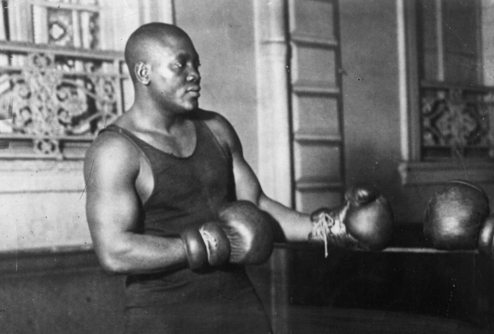 Jack Johnson (1878 - 1946) was one of the greatest yet most unpopular Heavyweight boxers of all time. In 1908 he took the world title from Tommy Burns and held on to it until Jess Willard beat him in 1915. (Topical Press Agency/Getty Images)