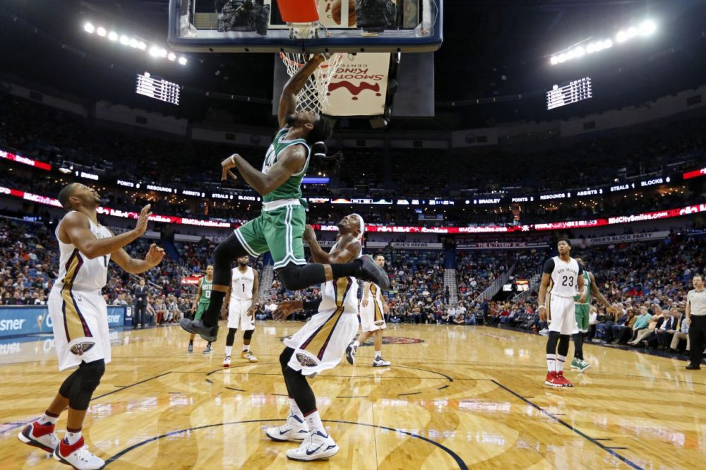Boston Celtics forward Jae Crowder (99) drives to the basket in front of New Orleans Pelicans guard Eric Gordon, left,  and forward Dante Cunningham during last night's game in New Orleans. (Gerald Herbert/AP)