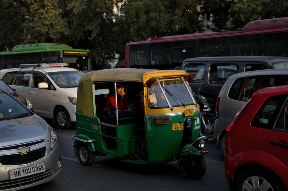 An Indian woman travels in an auto-rickshaw, a cheaper mode of three wheeler taxi service in New Delhi, India, Monday, Dec. 8, 2014. (Bernat Armangue/AP)