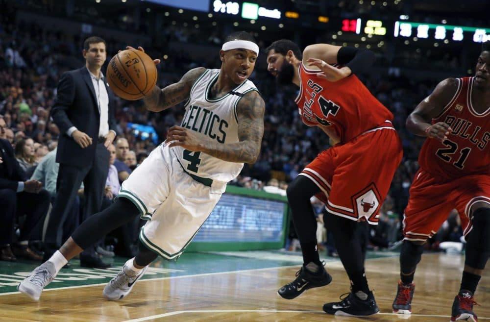Boston Celtics' Isaiah Thomas (4) drives past Chicago Bulls' Nikola Mirotic (44) during last night's game. The Celtics won 105-100. (Michael Dwyer/AP)