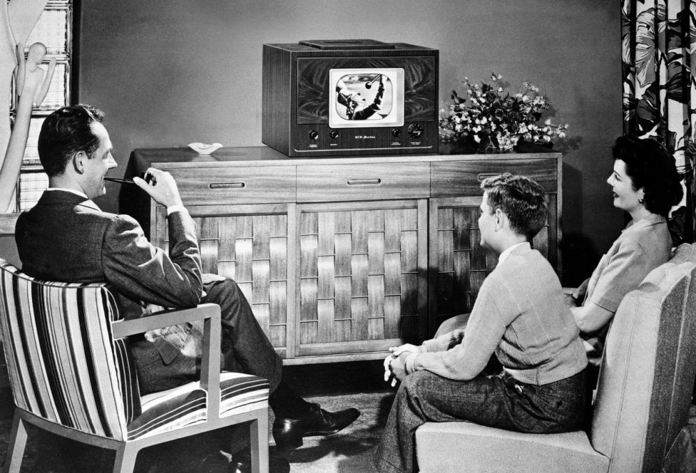 In this 1948 photo, an American family watches a tabletop radio television. (AP)