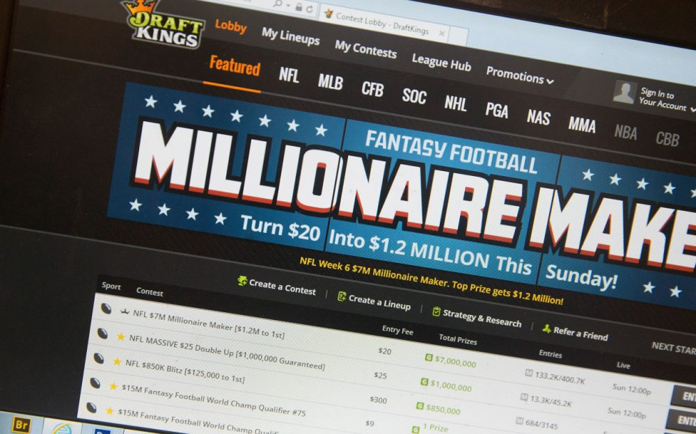 The fantasy sports website DraftKings is shown on October 16, 2015 in Chicago, Illinois. DraftKings and its rival FanDuel have been under scrutiny after accusations surfaced of employees participating in the contests with insider information. An employee recently finished second in a contest on FanDuel, winning $350,000. Nevada recently banned the sites.  (Photo illustration by Scott Olson/Getty Images)