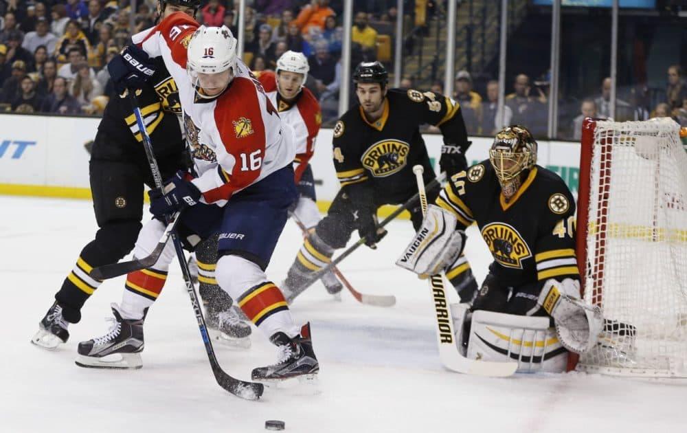 Florida Panthers' Aleksander Barkov (16) tries to get a shot off on Boston Bruins' Tuukka Rask (40) in Boston on Saturday. (AP Photo/Michael Dwyer)