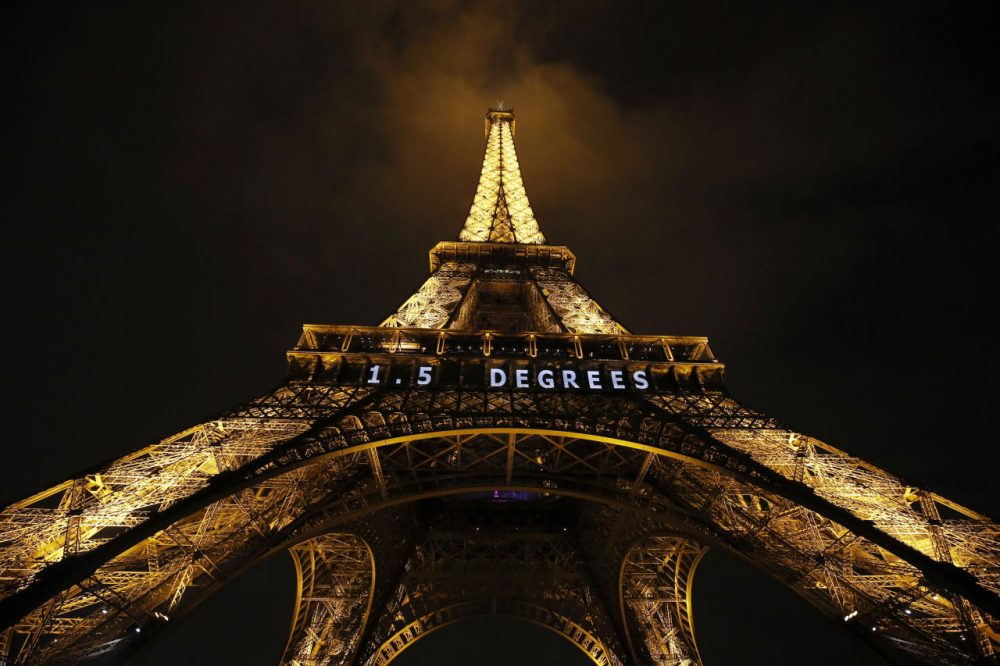'1.5 Degrees' in white neon is lit on the Eiffel Tower in the French capital, as the COP21 United Nations Climate Change Conference took place at Le Bourget, on the outskirts of Paris. (Patrick Kovarik/AFP/Getty Images)