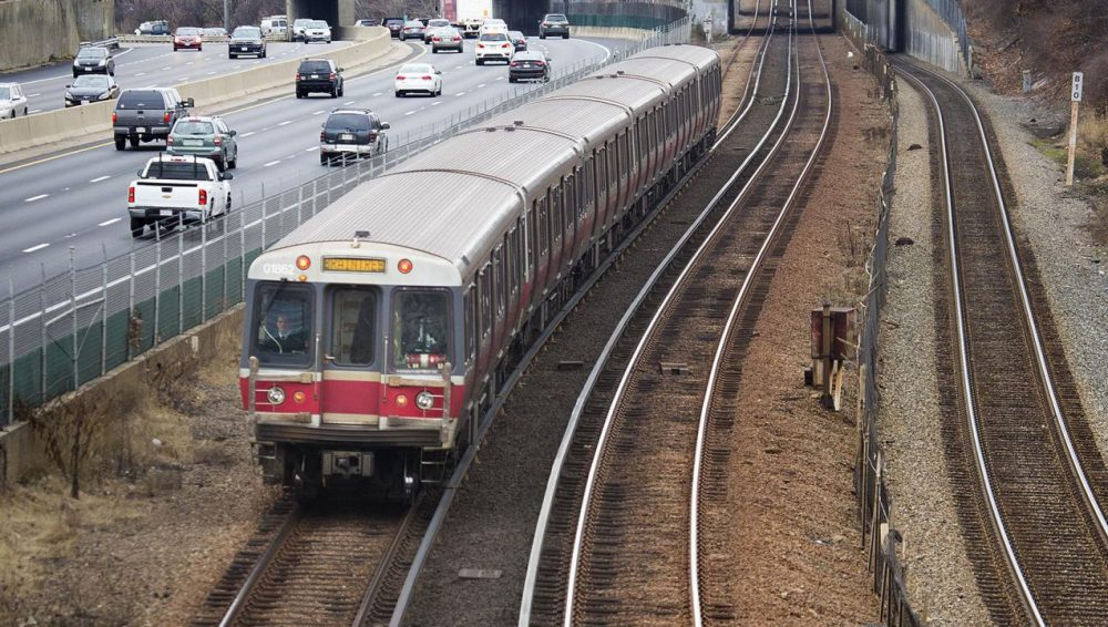 """The two workers are being awarded for their actions to shut down an MBTA Red Line train running on the tracks without an operator, in what the state transportation secretary called """"an unacceptable breach of our responsibility to keep riders safe."""" (Jesse Costa/WBUR)"""