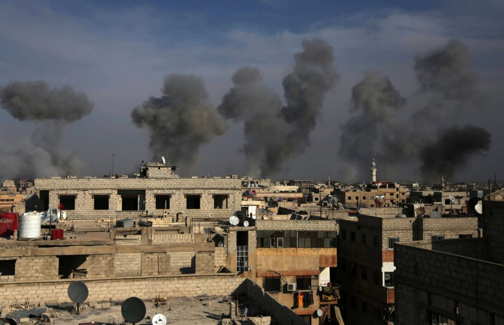 Smoke billows after air strikes by regime forces on the town of Douma in the eastern Ghouta region on Dec. 13, 2015. (Amer Almohibany/AFP/Getty Images)