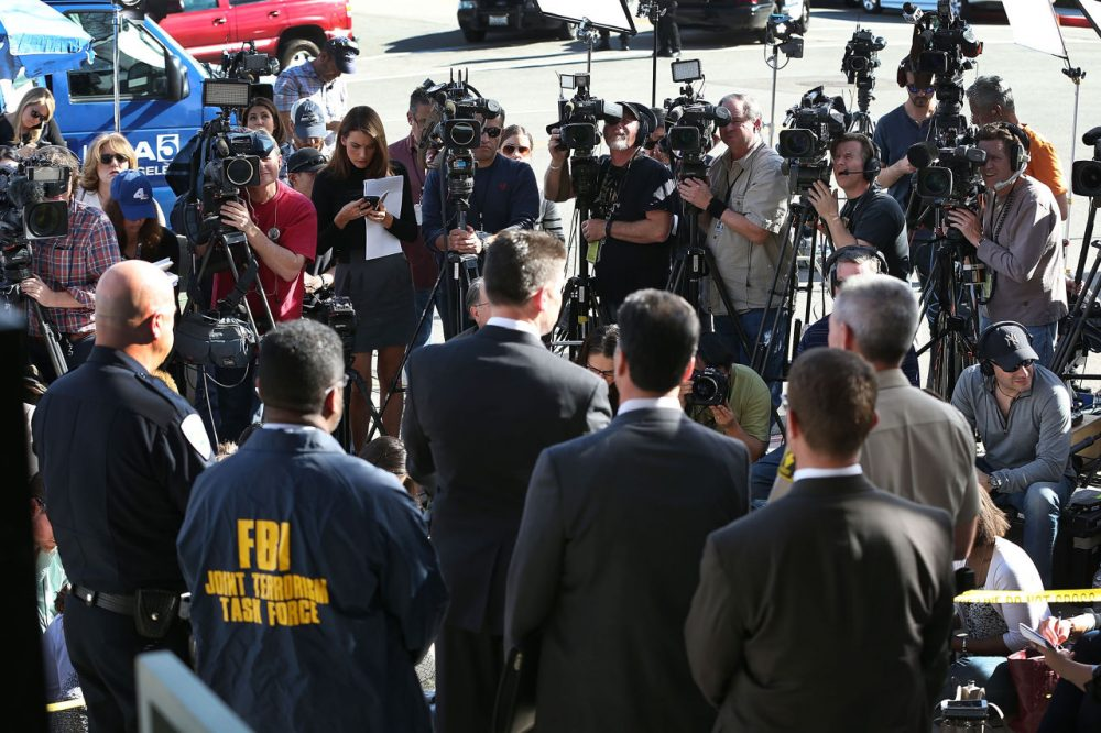 David Bowdich (C), FBI Assistant Director in Charge of the Los Angeles Field Office, stands with other law enforcement officials as he speaks to the media about the terrorist attack at the Inland Regional Center on December 7, 2015 in San Bernardino, California. (Joe Raedle/Getty Images)