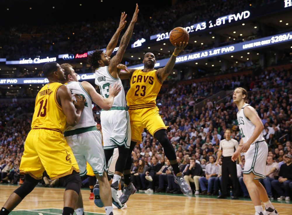 Cleveland Cavaliers' LeBron James goes past Boston Celtics' James Young during the fourth quarter of the Cleveland Cavaliers 89-77 win over the Boston Celtics last night. (Winslow Townson/AP)