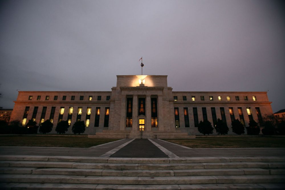 Flags fly over the Federal Reserve Building on Dec. 16, 2008, in Washington, D.C. The Fed is expected to announce today a raise in interest rates by a quarter of a percent. (Mark Wilson/Getty Images)
