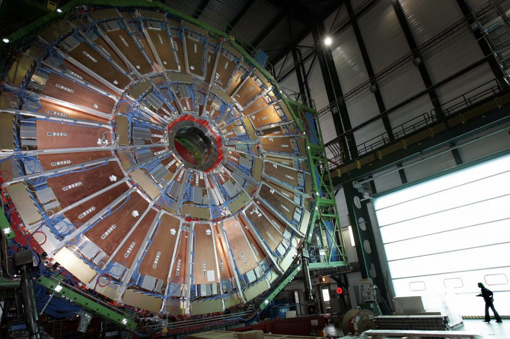 This file picture taken on March 22, 2007 shows a woman walking near the world's largest superconducting solenoid magnet (CMS), at the European Organization for Nuclear Research (CERN)'s Large Hadron Collider (LHC) particle accelerator in Geneva.  (Fabrice Coffrini/AFP/Getty Images)