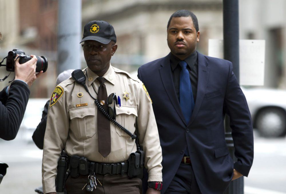 Officer William Porter, right, one of six Baltimore city police officers charged in connection to the death of Freddie Gray, arrives at a courthouse as jury deliberations continue in his trial, Wednesday, Dec. 16, 2015, in Baltimore Md. (Jose Luis Magana/AP)