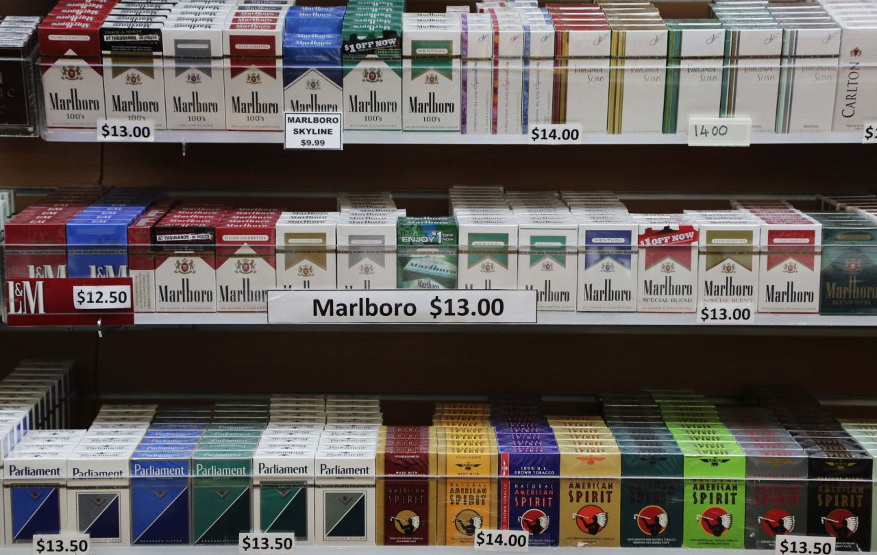 Cigarette packs are displayed at a convenience store in New York. (Mark Lennihan/AP)