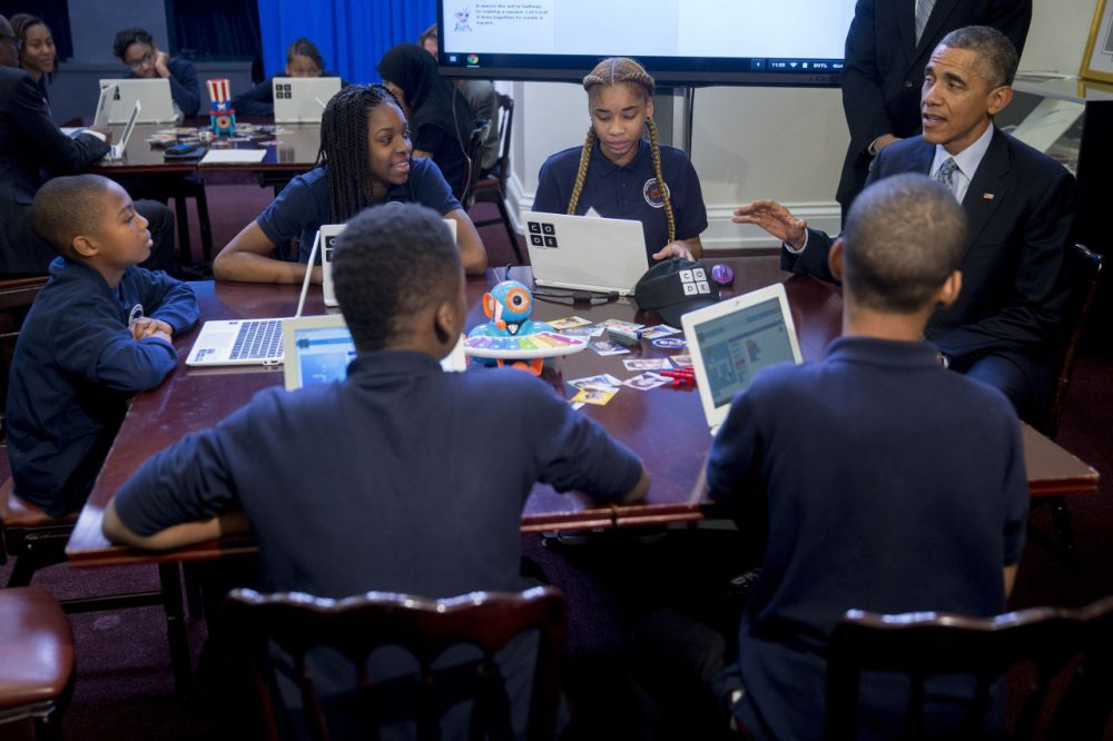 "U.S. President Barack Obama, right, talked to middle-school students who were participating in an ""Hour of Code"" event on December 8, 2014 in Washington, DC.  The event was in honor of Computer Science Education Week. (Andrew Harrer-Pool/Getty Images)"