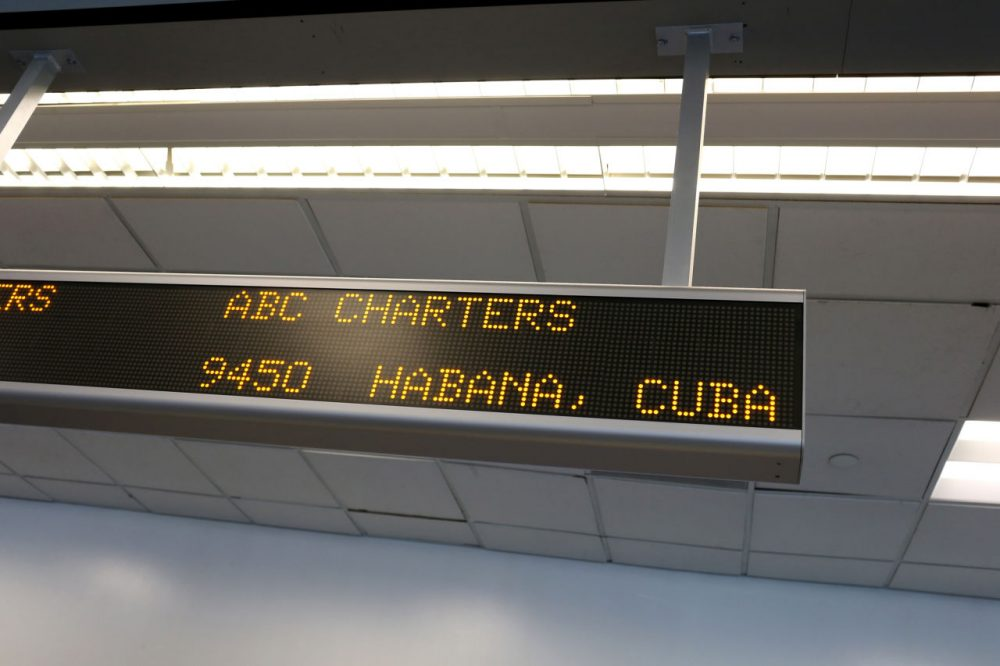 A sign indicates the ABC Charters American Airlines flight to Havana, Cuba at Miami International Airport on December 19, 2014 in Miami, Florida. The U.S. and Cuba have reached an agreement to allow commercial flights between the two countries. (Joe Raedle/Getty Images)