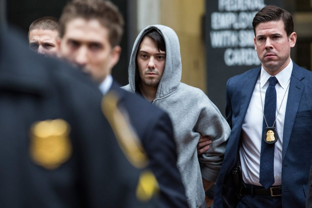 Martin Shkreli (center), then-CEO of Turing Pharmaceuticals, is brought out of 26 Federal Plaza by law enforcement officials after being arrested for securities fraud on December 17 in New York City. (Andrew Burton/Getty Images)