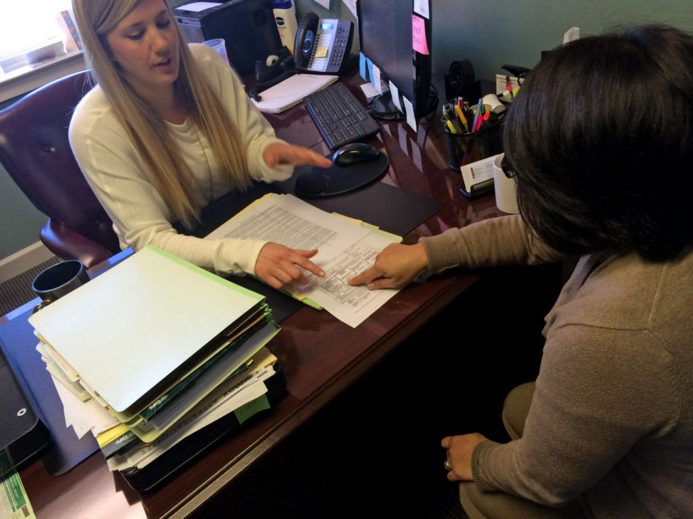 MaryLou, right, meets with lawyer Erin Witte in Fairfax City, Va. (Michael Pope/WAMU)