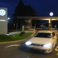 A car departs from an entrance gate at the Volkswagen factory and company headquarters on October 21, 2015 in Wolfsburg, Germany. (Sean Gallup/Getty Images)