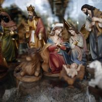 A picture taken on December 16, 2015 in the West Bank city of Bethlehem shows a Christmas manger displayed in front of a Christian souvenir shop on the Manger Square near the Church of the Nativity, revered as the site of Jesus Christ's birth. (Thomas Coex/AFP/Getty Images)