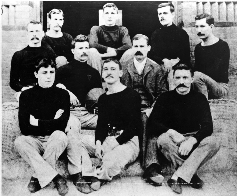 Dr. James Naismith -- the inventor of basketball -- sits with the first team in 1891 in Springfield, Massachusetts. (Hulton Archive/Getty Images)