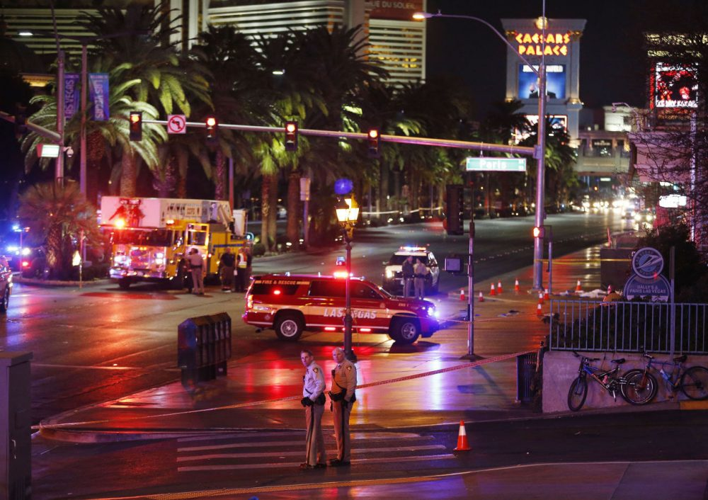 Police and emergency crews respond to the scene of a car accident along Las Vegas Boulevard on Sunday, Dec. 20, 2015. (John Locher/AP)