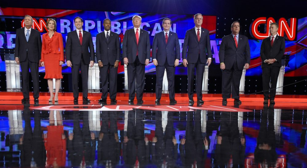 Republican presidential candidates, from left, John Kasich, Carly Fiorina, Marco Rubio, Ben Carson, Donald Trump, Ted Cruz, Jeb Bush, Chris Christie, and Rand Paul take the stage during the CNN Republican presidential debate at the Venetian Hotel & Casino on Tuesday, Dec. 15, 2015, in Las Vegas. (Mark J. Terrill/ AP)